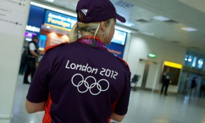 A London 2012 Games Maker stands ready at Heathrow